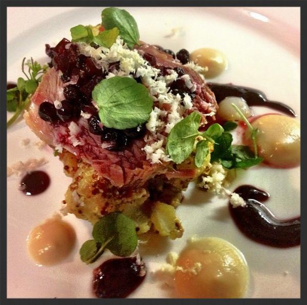 Corned Lamb Shoulder, Potato-Cippolini Salad, Huckleberries, and Cabbage Cream at Beast Restaurant  | Credit:  Instagram , scottvivian