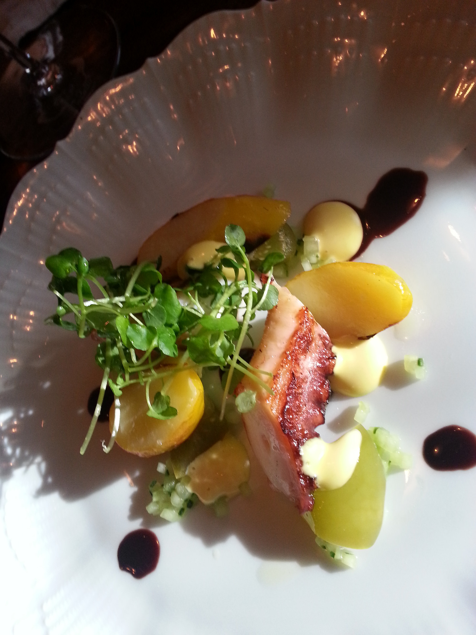 BBQ Octopus with potato, pickled tomatillo, cucumber, and black olive at Maude | FOODABLE WEBTV NETWORK