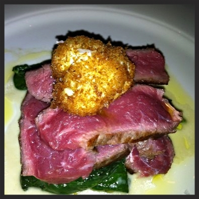 Wet aged New York strip with a deep fried poached quail egg at Carnevino  | YELP, Siao J.