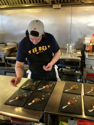 Chef at El Ideas prepares dishes in front of diners  | YELP