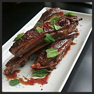 Baharat spiced lamb ribs, pomegranate molasses, mint and marash pepper at Levant  | Facebook, Levant