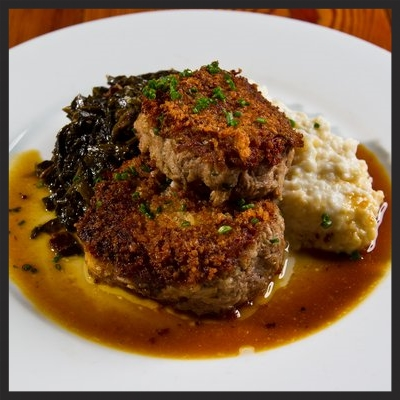 Pan Fried Pork Shoulder, Coosa Valley Grits, Braised Greens, Mustard Jus at Sylvain  | YELP, Sean M.