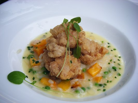 Sweet breads over squash risotto at the Belgian restaurant, Brasserie Beck | YELP, Lynn N.