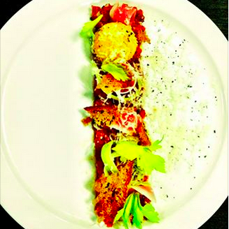 Wagyu Beef Tartare with truffle cheese, celery, egg yolk & watermelon radish | Credit: Acorn