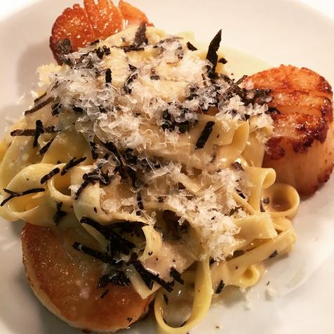 Diver scallops with homemade fettuccini, black truffles & Reggiano cheese | Credit: Bourbon Steak