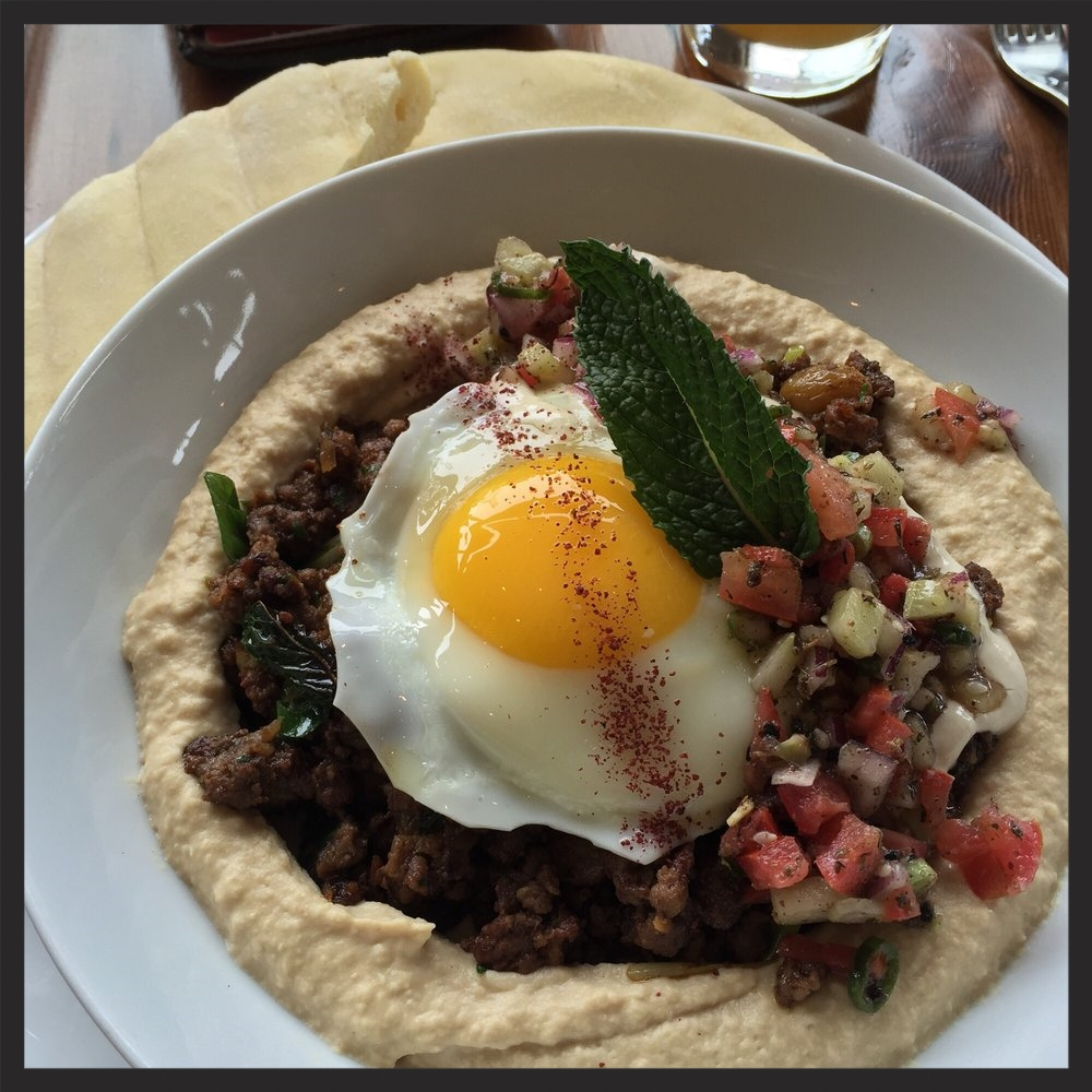 Hummus with spicy lamb, served with an egg on top  | Yelp, Rudrajit D.