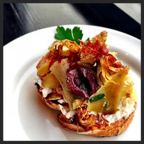 Housemade ricotta, artichokes three ways, Nicoise olive on toasted sourdough at RPM Italian  | Instagram, @rpmitalian