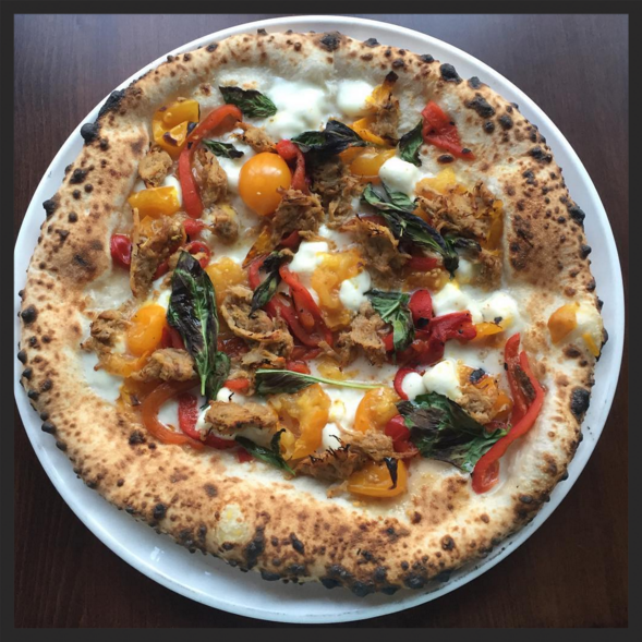 Pizza at Brigantessa (yellow tomatoes, pork ragu, buffalo mozzarella, roasted red peppers, basil, lemon, Calabrian chili oil)  | Instagram, @brigantessaphila