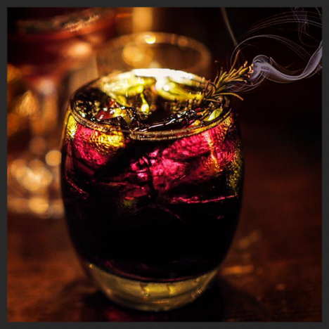Le Vamp Noir cocktail at Justine's Brasserie (black rum, fernet, creme de cacao, Angustura bitters, rosemary on fire)  | Instagram  @justinesbrasserie