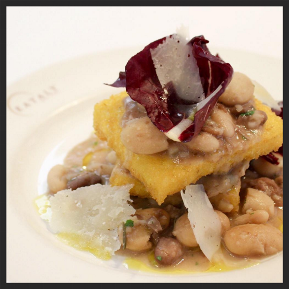 Polenta con fagioli e spinaci with crispy wild hive polenta, bean ragu, radicchio, shaved Parmigiano Reggiano at Eataly's Le Verdure  | Instagram @eatalyusa