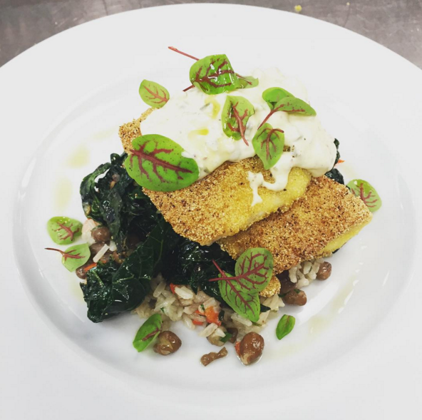 Cornmeal crusted speckled trout with Hoppin' John, sautéed kale and a pickled okra and jalapeño tartar sauce  |  Instagram @angeline_nola