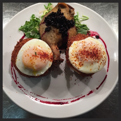 Poached Eggs at Boulevardier  | Facebook