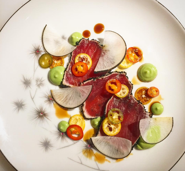 Tuna crudo, sesame, avocado, pickled chile, Kentucky bourbon barrel soy, black radish, kumquat at Mabel Gray  | Instagram @ChefJamesRigato