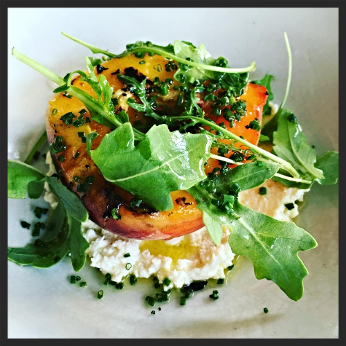 Grilled peach with house made ricotta and olive oil at Rich Table |  Instagram @richtable