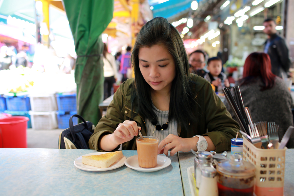 Lady Drinking Latte at Chinese Market