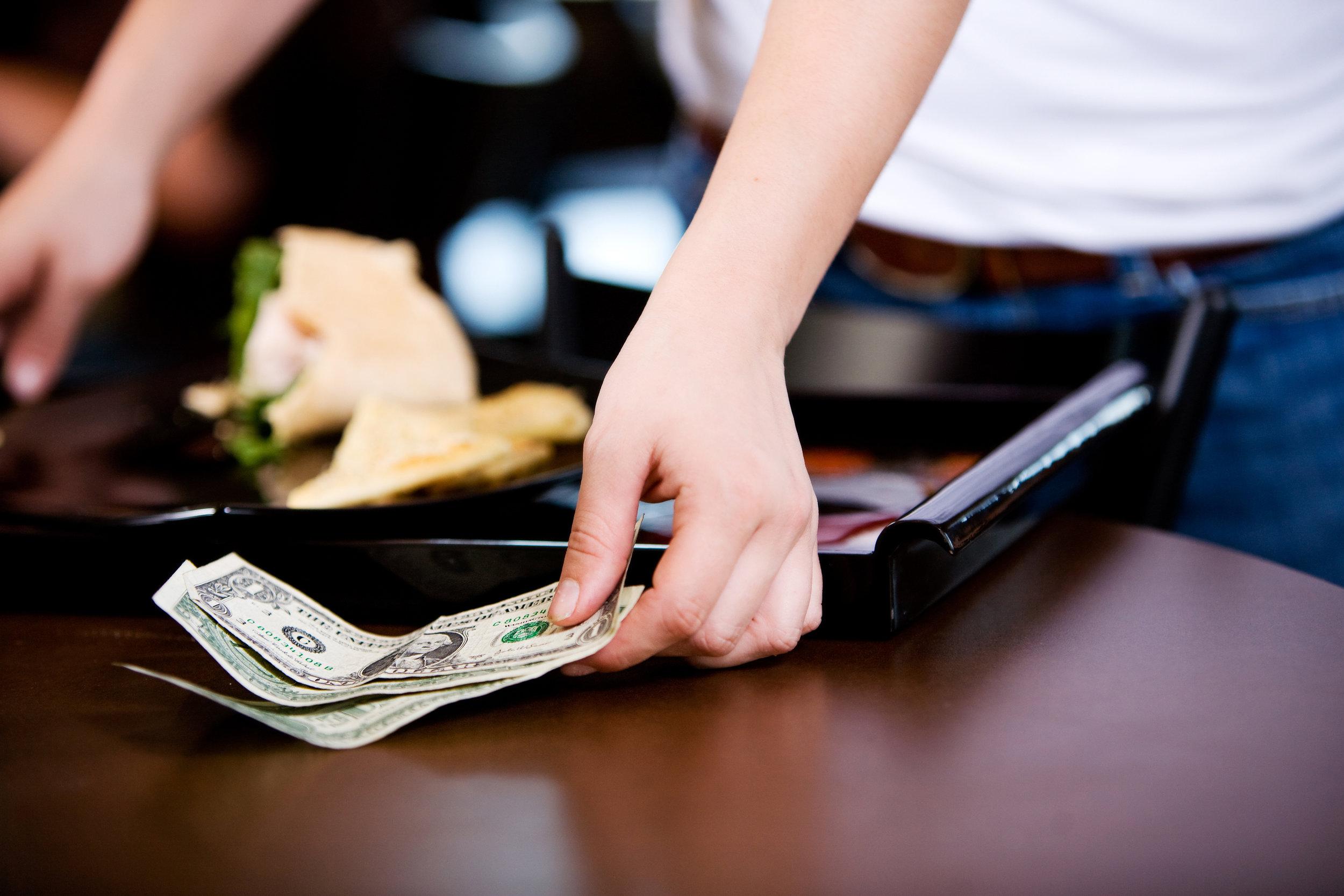 restaurant worker with tip