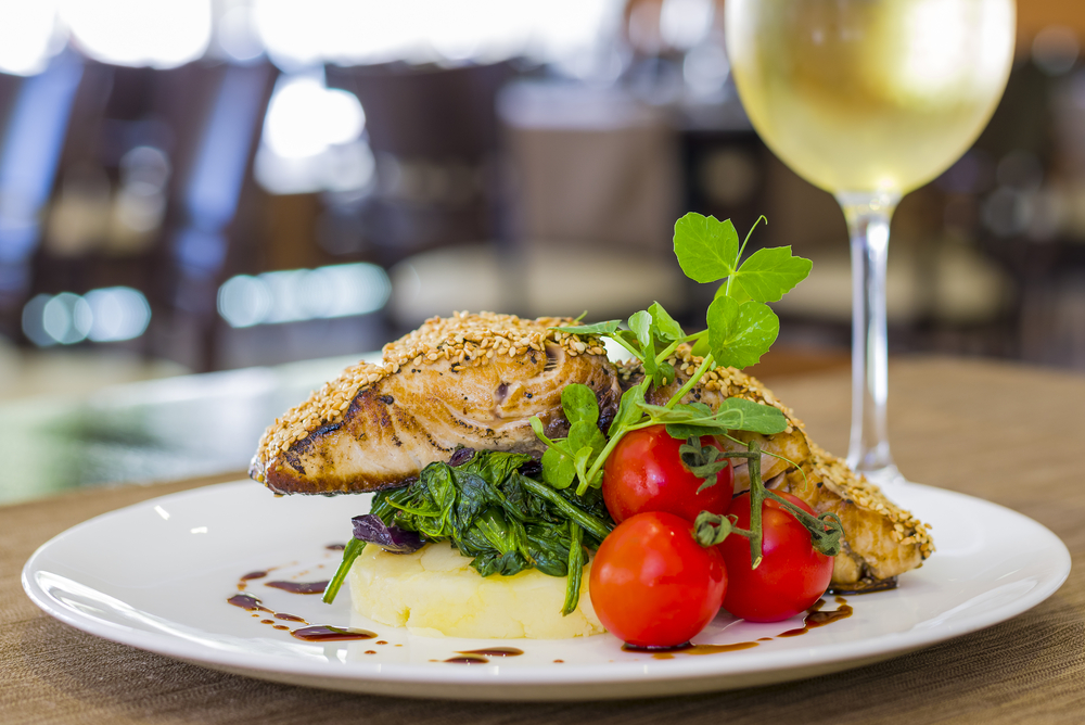 Grilled fish with a white wine glass
