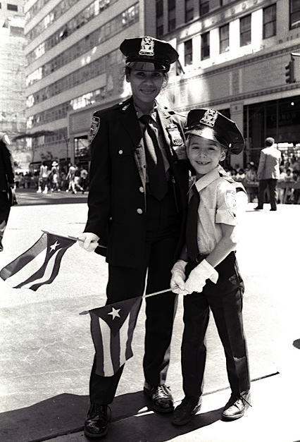 Police officer and son, Puerto Rican Day Parade, NYC