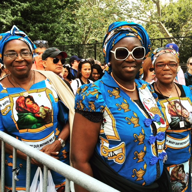 Women from Nigeria on line into Central Park to the Pope.