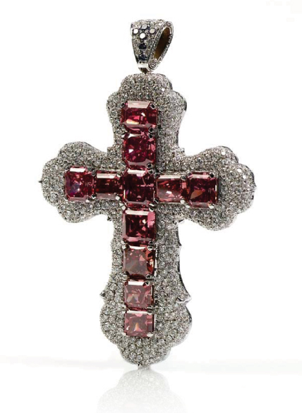 Image: The Red Wonder Cross. It was designed by Oren Seren, Master Diamond Cutter of Seren Diamonds, and features 11 fancy red diamonds (0.42-0.93 carats), as well as colorless and blue diamonds, set in white gold. Source:    http://www.serendiamonds.com/