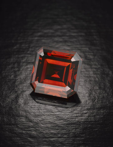 Image: The Kazanjian Red Diamond. The gem was discovered in the 1920s in Litchenburg, South Africa. When found, it was a hefty 35 carats uncut. After cautious cleaving and polishing, the gem emerged a 5.05-carat emerald cut. In candlelight, the Kazanjian Red Diamond appears as vivid as a drop of blood splashed on a white diamond. Source: NY Times.