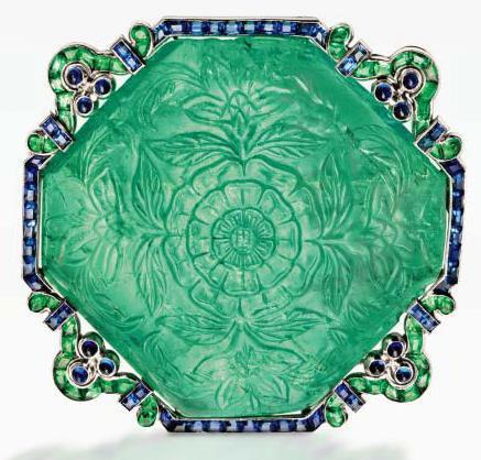 The carved emerald dates from the late-17th to early-18th century, and was set within the elegant and understated mounting by Cartier in the 1920s. Photo: Sotheby's