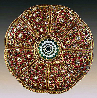 Highly detailed plate. 17th century, Mughal India. Gold, kundan setting technique, uncut diamonds, rubies, emeralds and enamel. Presented by the ambassadorial mission of Iranian ruler Nadir-Shah to the Russian Imperial Court, 1741. Photo: State Hermitage Museum.