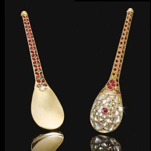 Golden spoon, quite literally!  A rare Mughal gem-set gold spoon, India, 17th-18th century. The back is delicately inlaid on the reverse with a lotus rosette comprised of radiating foil-backed diamond petals and rubies, the faceted tapering shaft inlaid with emeralds and bands of ruby quatrefoils within an engraved and chiseled gold framework. Photo: Sotheby's.