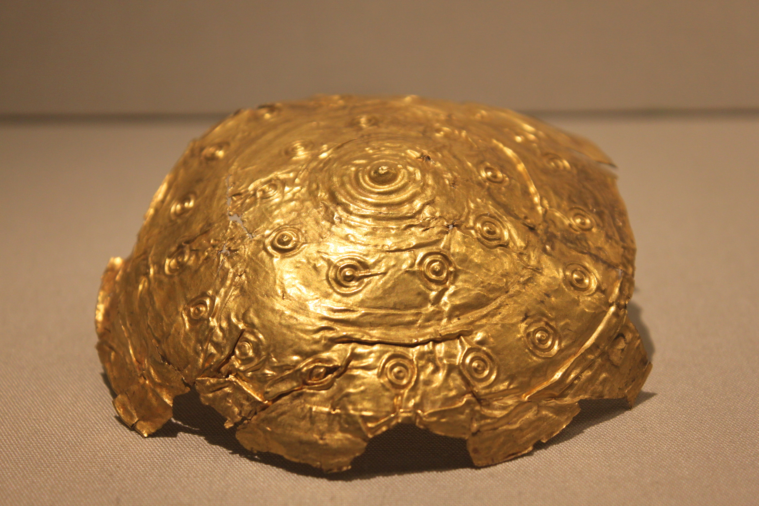 Gold disc, perhaps a terminal from a collar or ear spool. 800-700 BC. National Museum of Ireland.