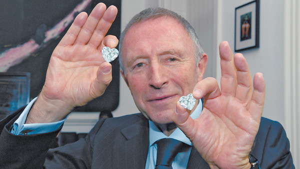 "Mr. Laurance Graff holding the perfectly matched ""Graff Sweethearts""."