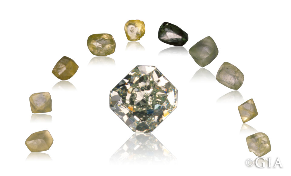 A 4.24-ct. natural-color Fancy green diamond surrounded by a suite of yellow to green rough diamonds. Courtesy American Siba Corp. (cut stone), Cora Diamond Corp. (rough crystals). Image: GIA