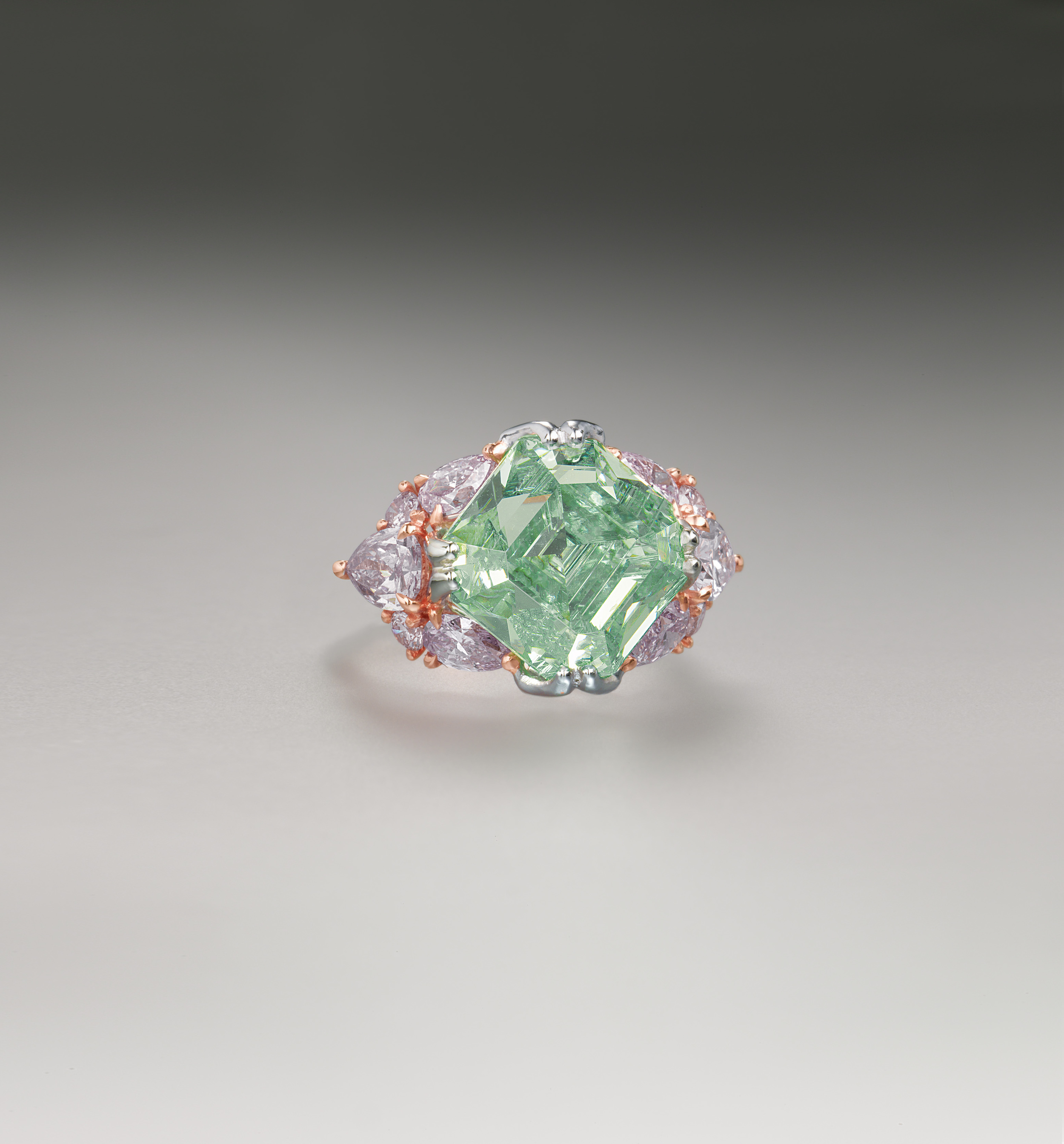 A square-shaped fancy green diamond weighing 10.36 carats, set in a ring within a pear-shaped and round cut pink diamond surround. Image: Christie's Hong Kong, 2008.