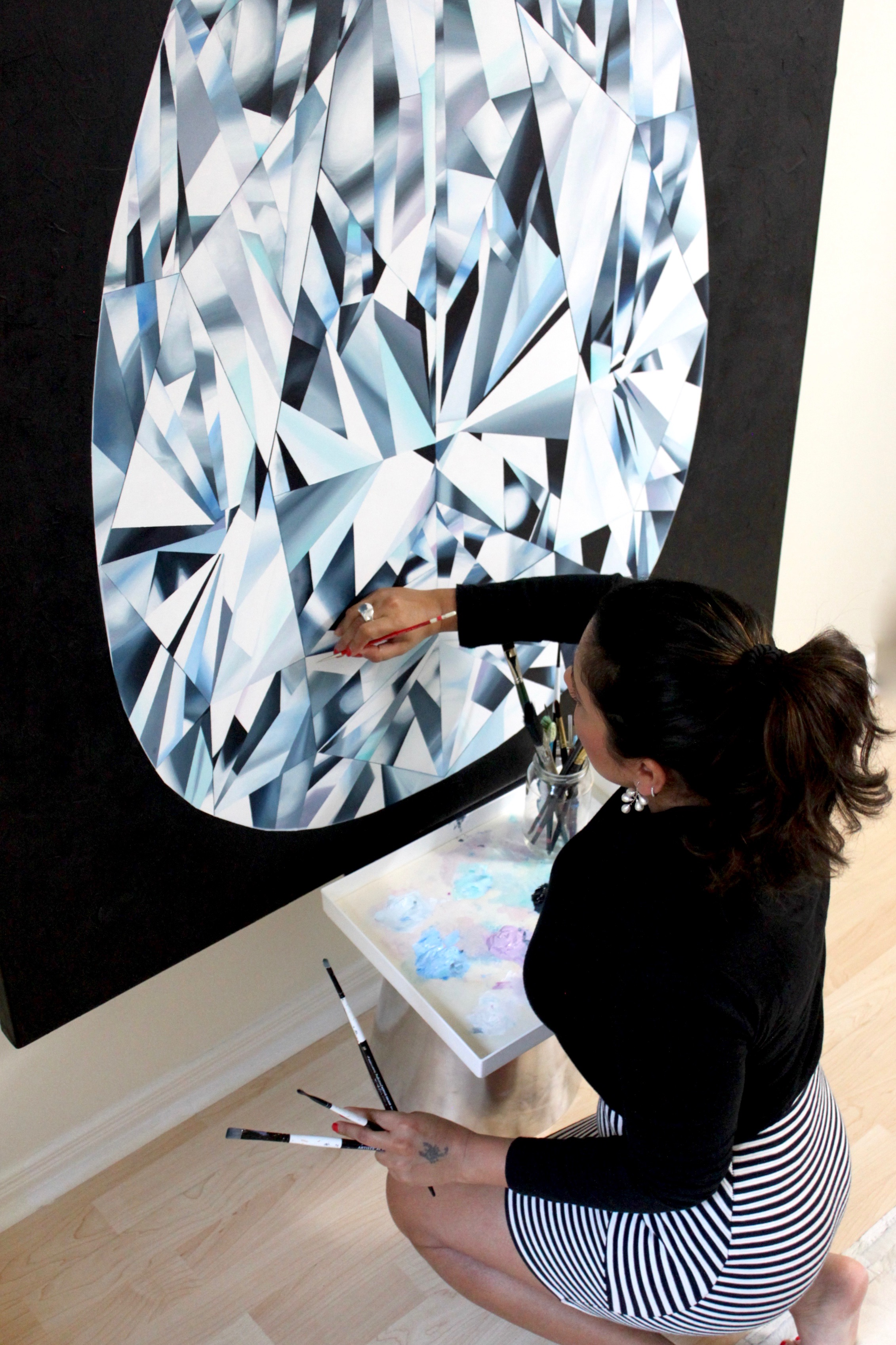 """Reena Ahluwalia during the making of the """"The Portrait of Perfection"""" - Portrait of a Pear Shaped Diamond. 60""""x 48"""" [5.0 x 4.0 Ft]. Acrylic on Canvas. ©Reena Ahluwalia"""