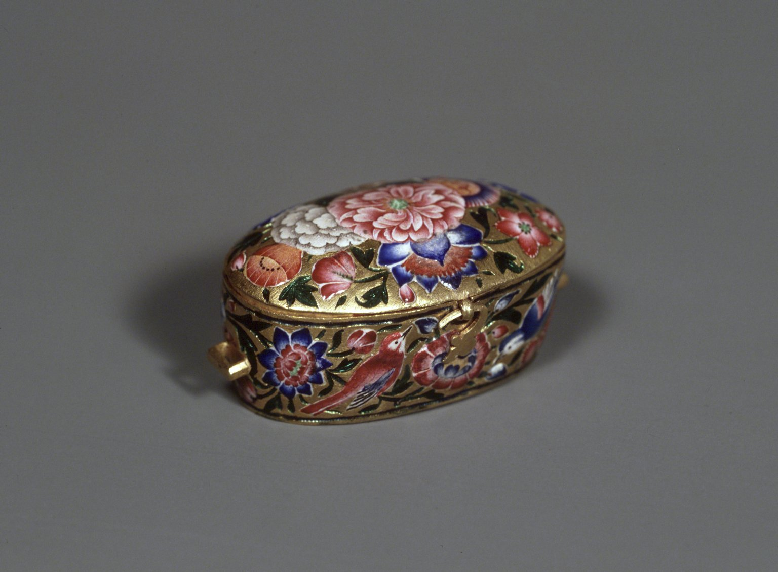 Amulet Box, 19th century. Gold, polychrome enamel, and repoussé decoration, 7/8 x 1 7/8 in., 0.1 lb. (2.3 x 4.8 cm). Image: Brooklyn Museum