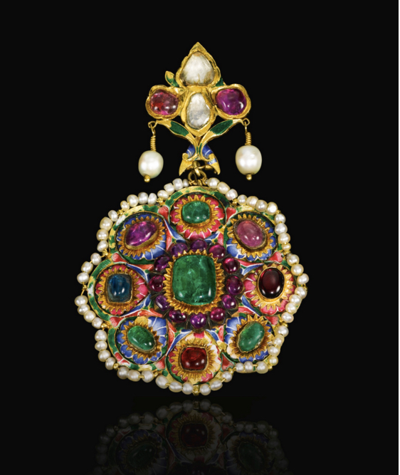 A large Qajar polychrome enamelled and gem-set gold pendant, Persia, 19th century of flowerhead form, the central raised emerald encircled by rubies, each petal with enamelled blue or pink ground surmounted by a ruby, emerald or sapphire, with a seed-pearl border, the reverse with polychrome enamelled design of birds and a butterfly amidst floral motifs, surmounted by a gem-set and enamelled bud-shaped section. Image: Sotheby's