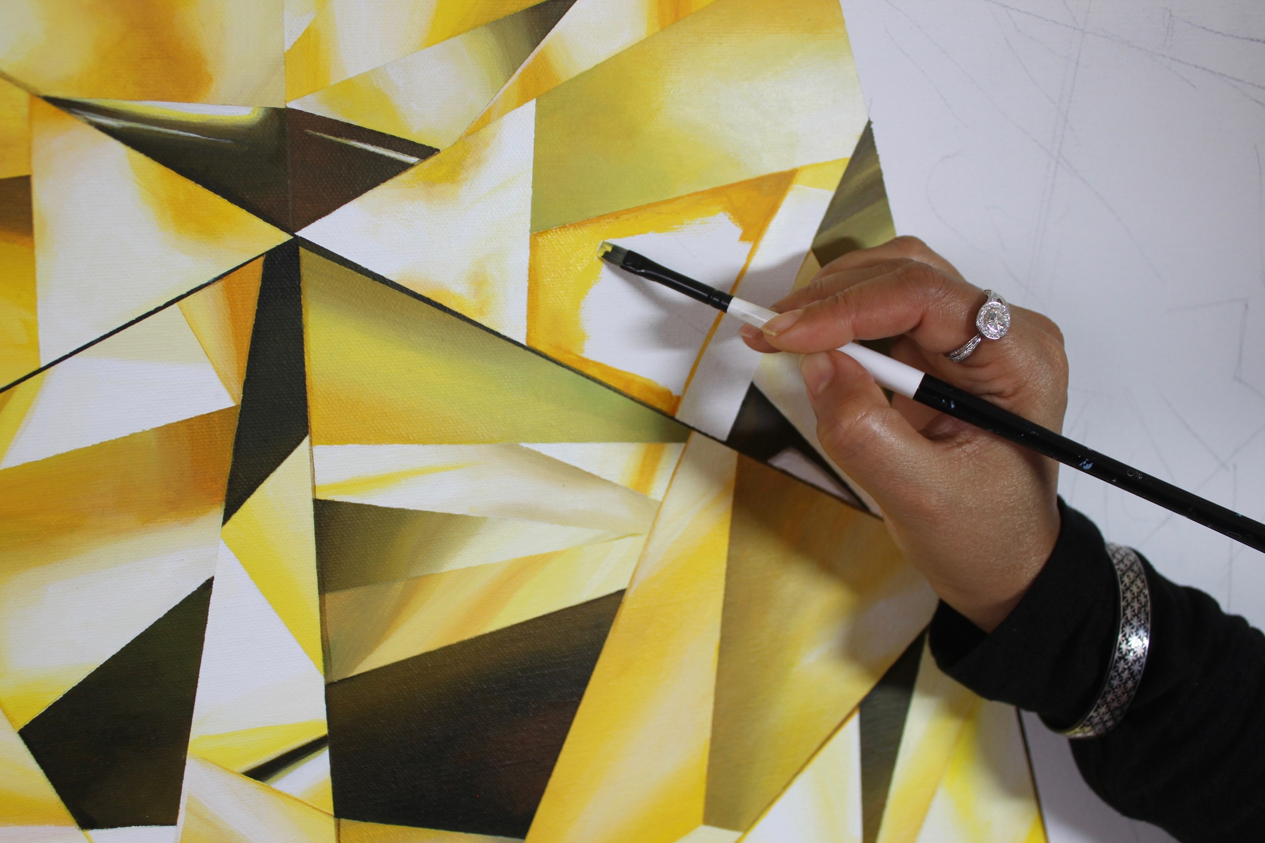 How many shades of yellow can you see? I work my brush in layers of color, slowly developing the nuanced coloration that a diamond has. Making of 'The Portrait of Luminosity' - Portrait of an Oval Cut Yellow Diamond. 60 x 48 inches. Acrylic on Canvas. ©Reena Ahluwalia