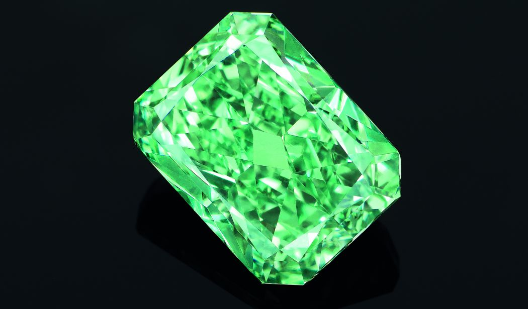 """'Aurora Green' is a 5.03 carat Fancy Vivid Green diamond, one of the rarest colour grading for a diamond and the largest of its kind ever to be offered at auction. It was sold for $16.82 million  at  Christie's auction, Hong Kong on May 31, 2016, making it the most expensive green diamond ever auctioned. """"The diamond got its name from the natural phenomenon """"aurora borealis"""" or """"aurora australis,"""" with the diamond's saturated color and scintillation emulated by the magical display of dancing lights that can only be seen above the magnetic poles of the northern and southern hemispheres. The auroral display appears in a spectrum of colors, but vibrant, vivid greens are the most anticipated and admired. It is only this natural marvel that can fittingly describe the natural wonder that is this diamond."""" -- Christie's Vickie Sek. Image: Christie's"""