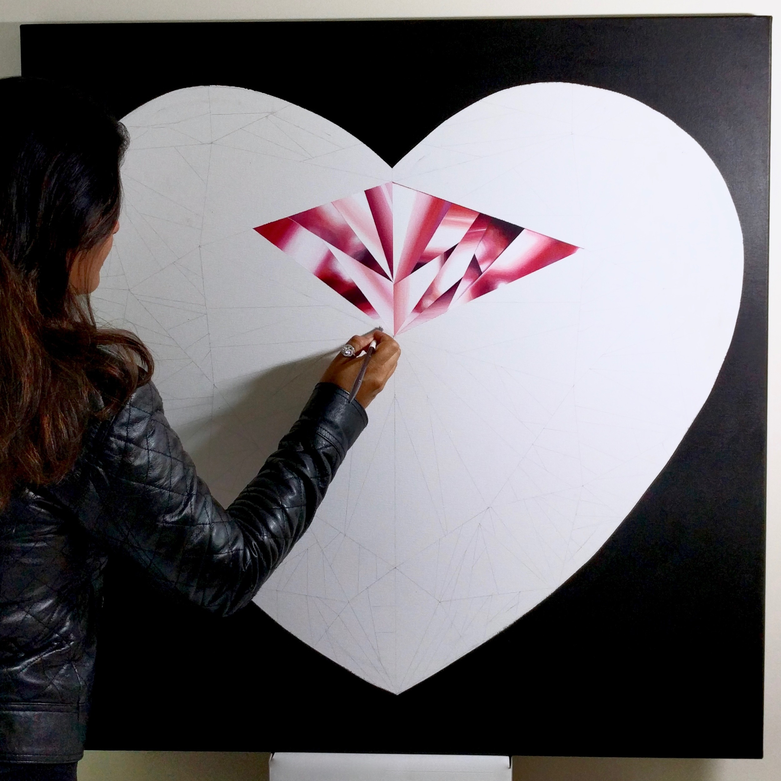 Life full of passion is a beautiful one! Reena Ahluwalia in her studio working on the 'Passionate Heart' - Portrait of a Pink Heart-Shaped Diamond. 36 x 36 inches. Acrylic on Canvas. ©Reena Ahluwalia