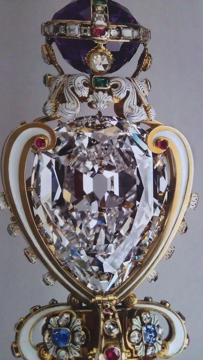 The Sovereign's Sceptre with Cross that is set with the largest of the Cullinan diamonds known as the Star of Africa or Cullinan I that weighs 530.2 carats. The Sceptre is part of the Crown Jewels. Image via: The Jewellery Editor