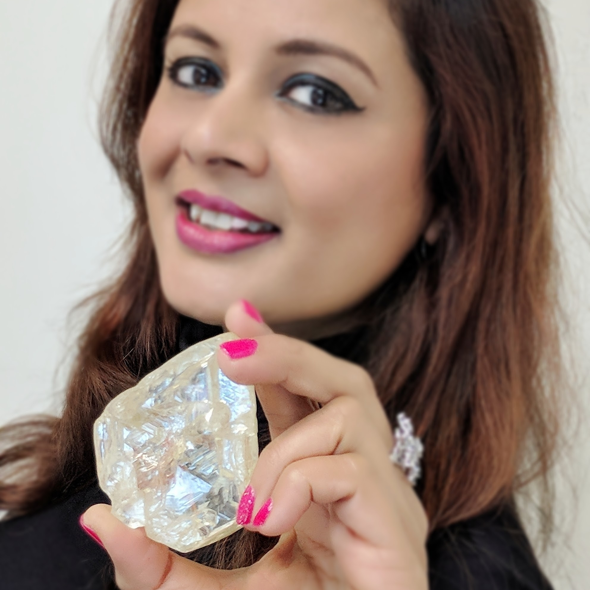 The    Peace Diamond    is the 15th largest diamond in the world. At 709-carat it was discovered in Kono region of Sierra Leone, the rough is 2.5 inches wide and 1 inch deep. In spite of offers to smuggle it, village leader Pastor Emanuel Momoh insisted that the diamond be sold through official government channels so that the financial benefits of this diamond would be properly shared with his village, district and the poverty stricken people of Sierra Leone. The Peace Diamond was sold to House of Graff on Dec 4, 2017. Image: Reena Ahluwalia holding the Peace Diamond at Rapaport New York.