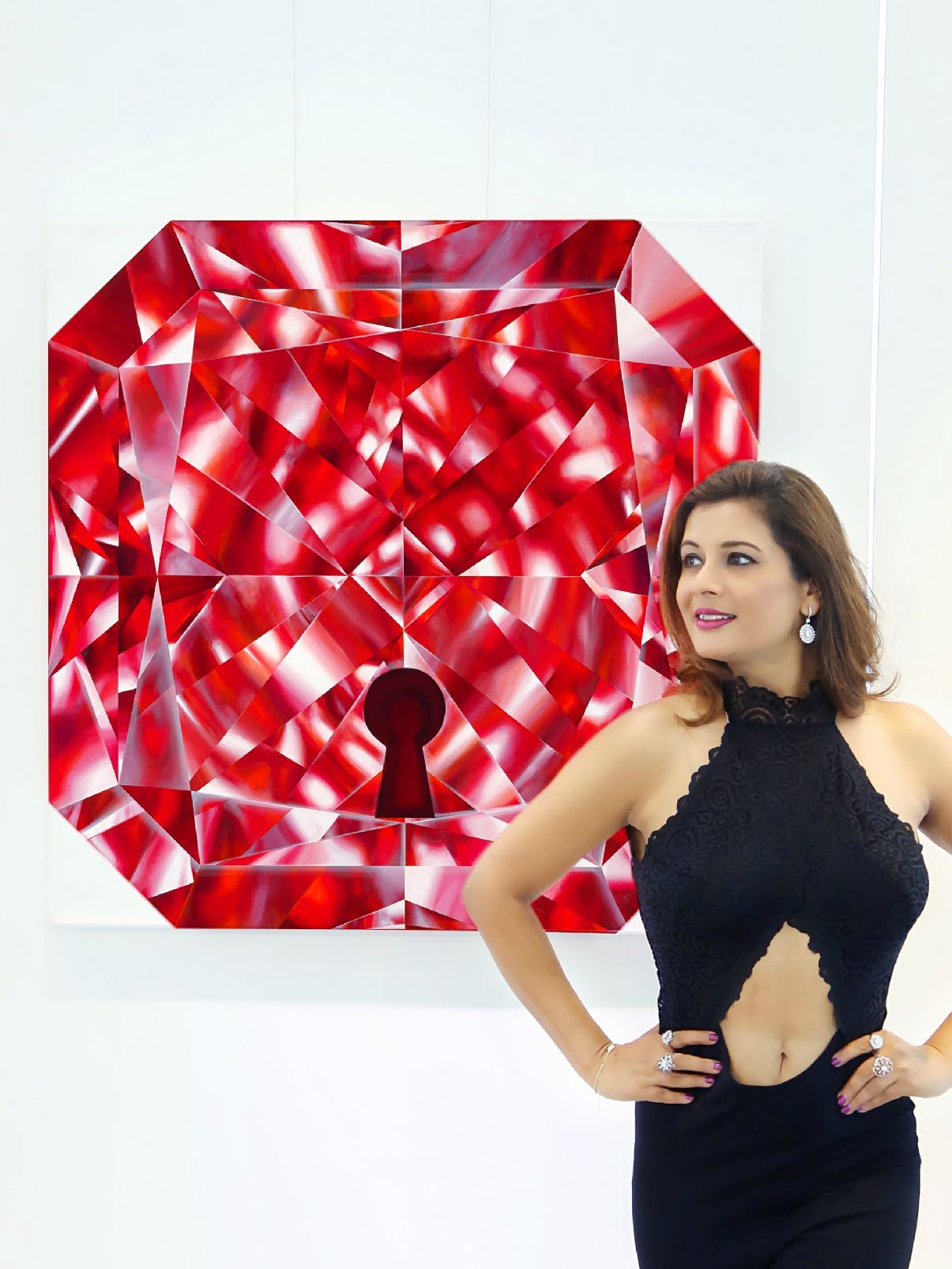 Artist Reena Ahluwalia with her Red Diamond Painting, titled 'Unlock'. See Reena's paintings    here   .