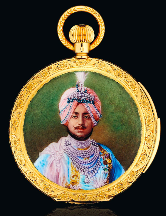 An enamel and gold hunting case pocket watch. Champlevé enamel portrait depicting Maharaja Bhupinder Singh of Patiala, enamel coat of arms on the reverse, white enamel dial, 18k gold, circa 1930. Image: Christie's