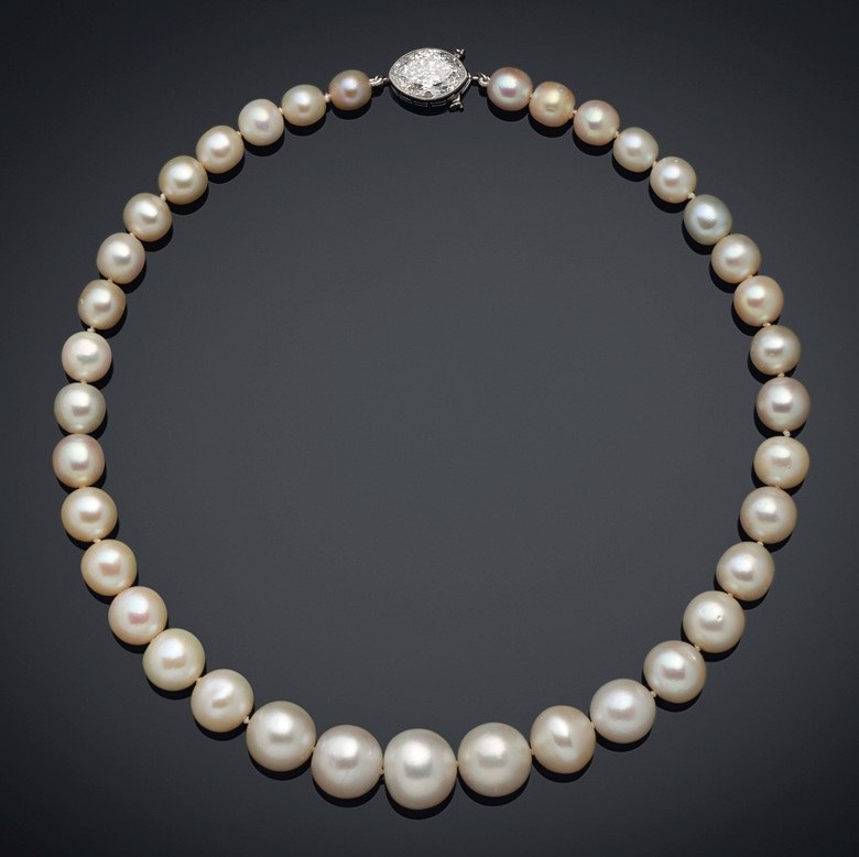 A single-strand natural pearl and diamond necklace, Cartier. Graduated strand of 37 natural pearls of 14.00 to 7.05 mm, old-cut marquise-shaped diamond, platinum (French marks). Image: Christie's