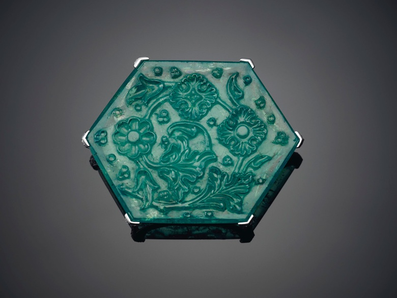 The Taj Mahal Emerald, Cartier. Hexagonal-shaped carved tablet emerald of 141.13 carats, circular-cut diamonds, platinum and 18k white gold. Mount by Cartier. Image: Christie's