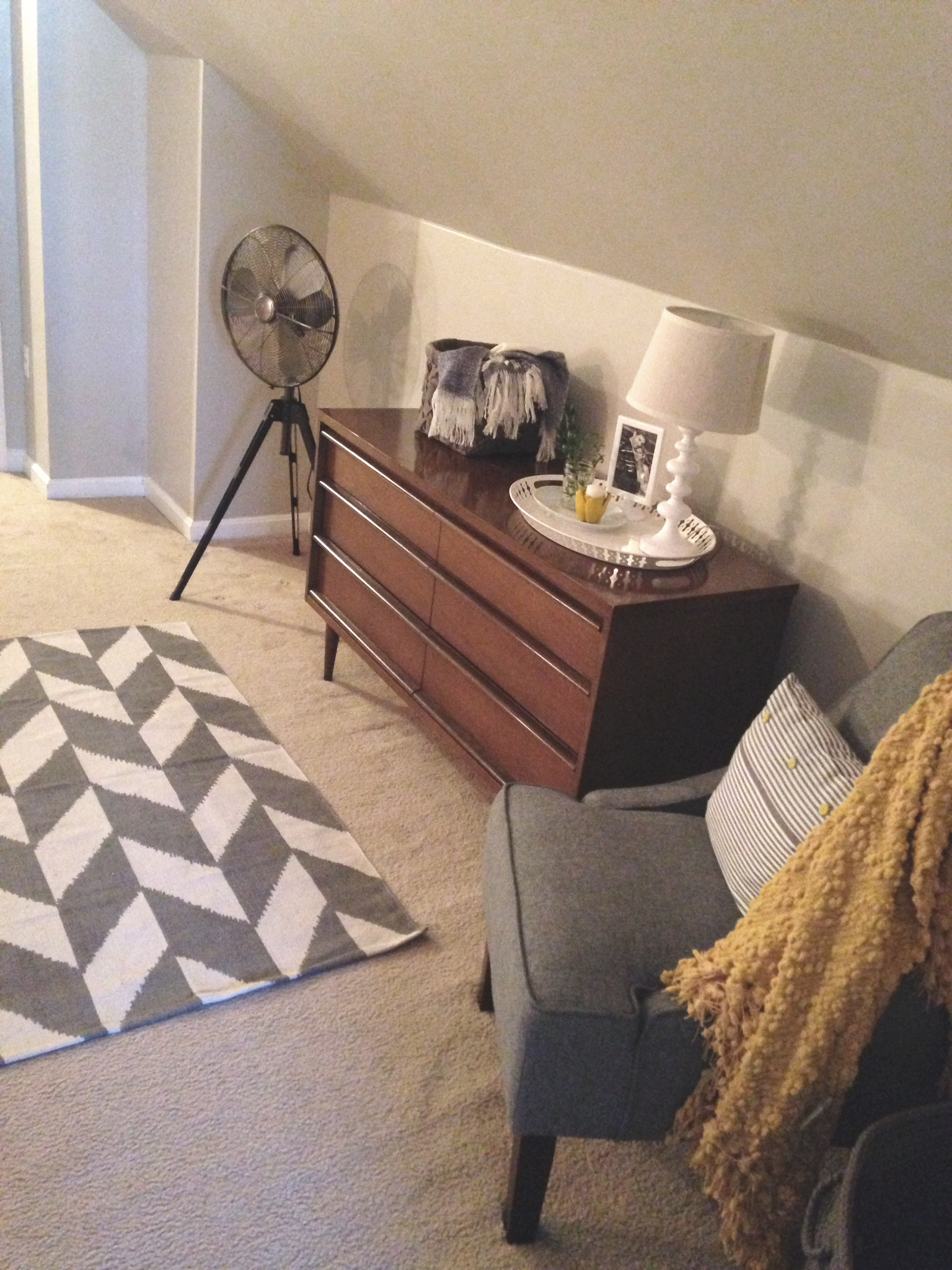 Here is the aforementioned dresser and a chair I picked up for cheap at Target. I made the throw pillow from a pillow case I got for a couple bucks in the IKEA as-is section. The Hunter fan was on end of season clearance at Target for less than $30. I love it.