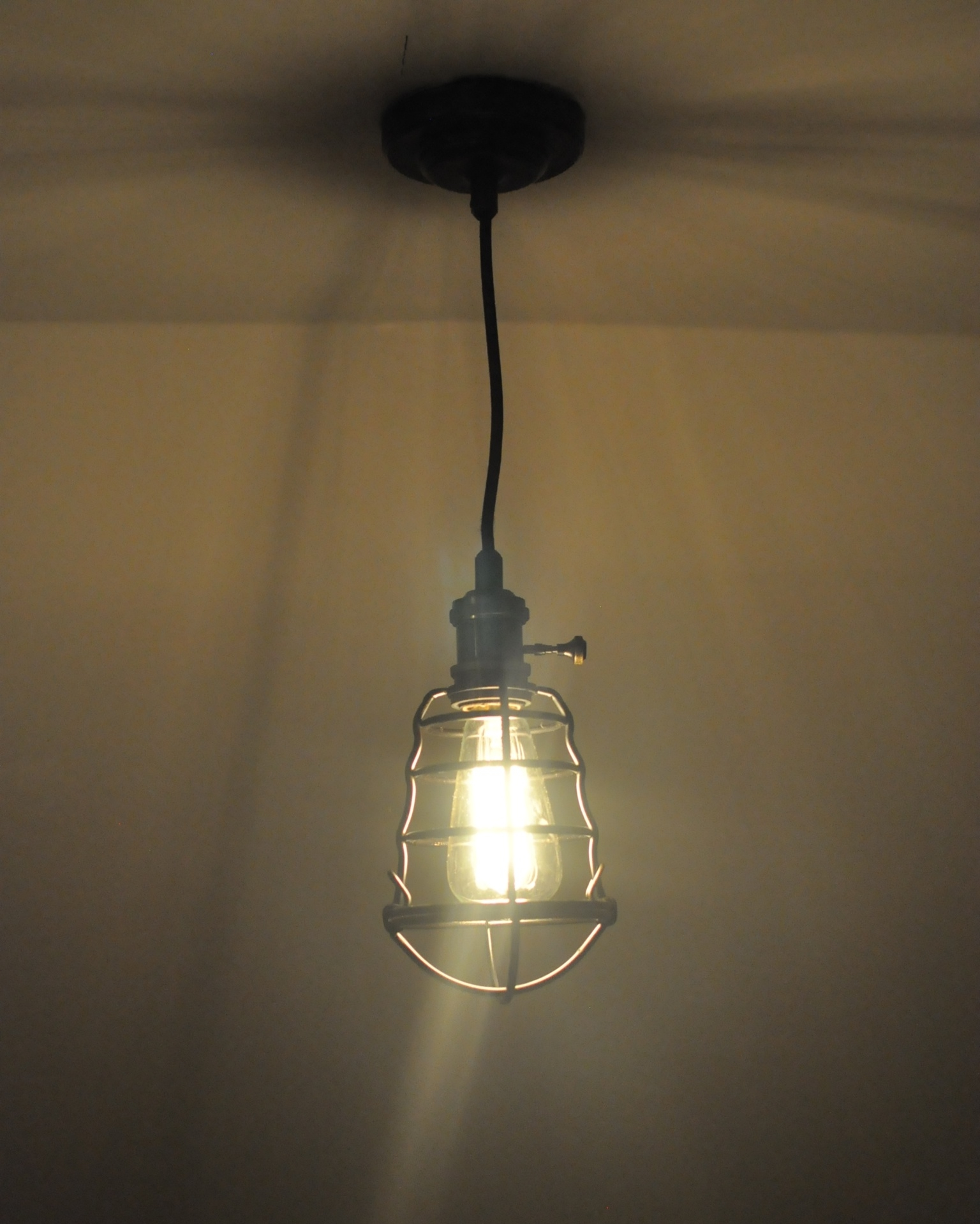 One challenge of the space was that the lightbulb socket over the bed didn't have it's own light switch, so I had to find a pendant fixture with a pull chain or turnkey. Most of the cool ones I found were pretty expensive on Etsy, but thankfully I found a more reasonable option at Home Depot.