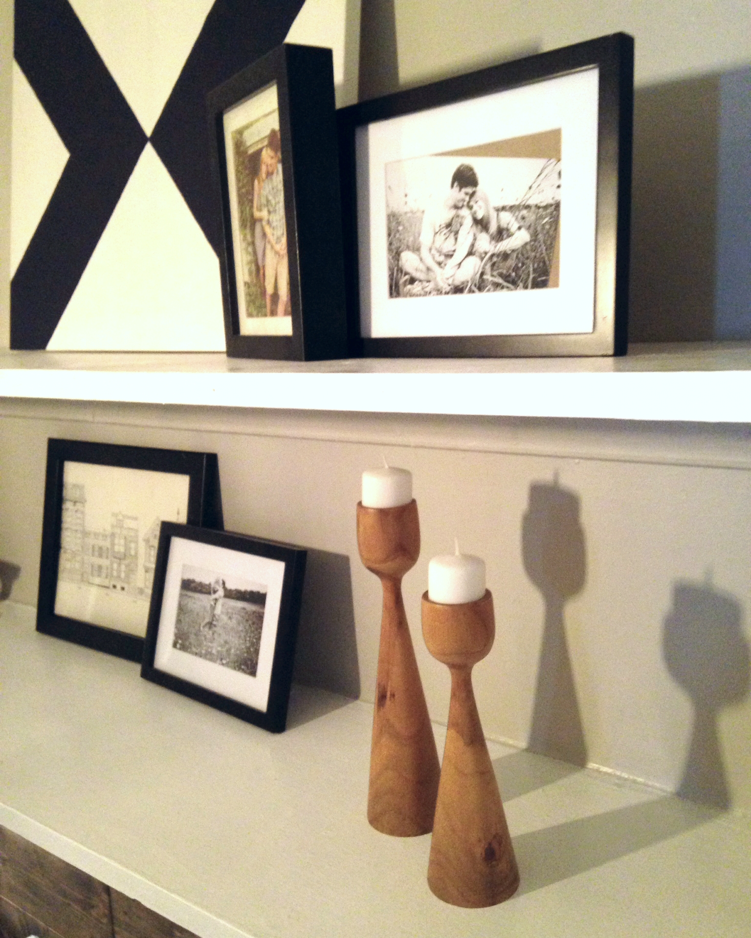 Most of the stuff on the shelf was just rearranged from what Naomi already had on hand, but I added a fun DIY canvas and and pair of candlesticks I picked up for $3 at the thrift store. They look very much like the pair West Elm sells here.