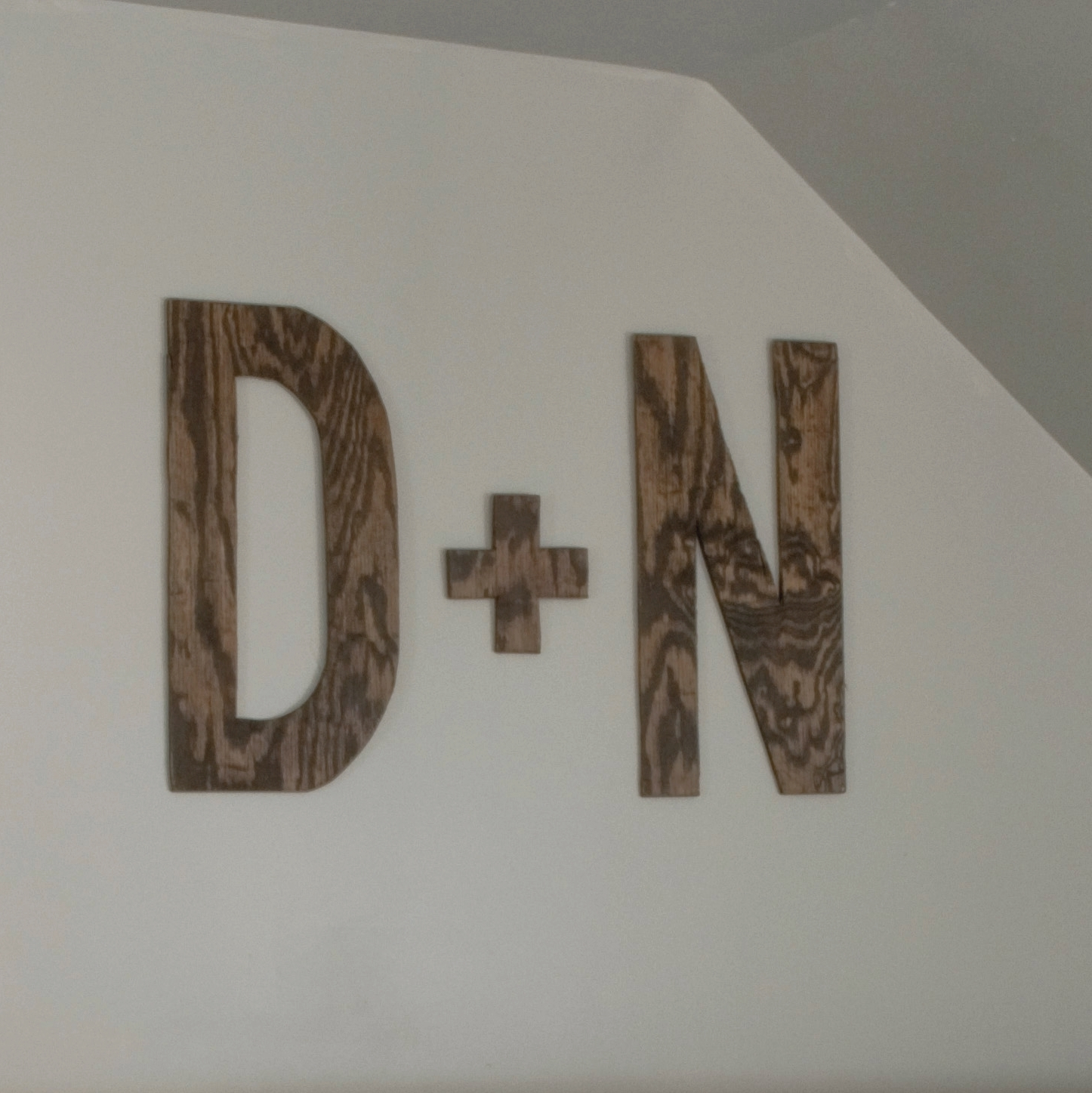 I made some large plywood letters out of the leftover plywood backer for the headboard. I kept them pretty rustic (meaning I couldn't make a straight line with the jigsaw, and I didn't bother with sanding them...) I love them, though.