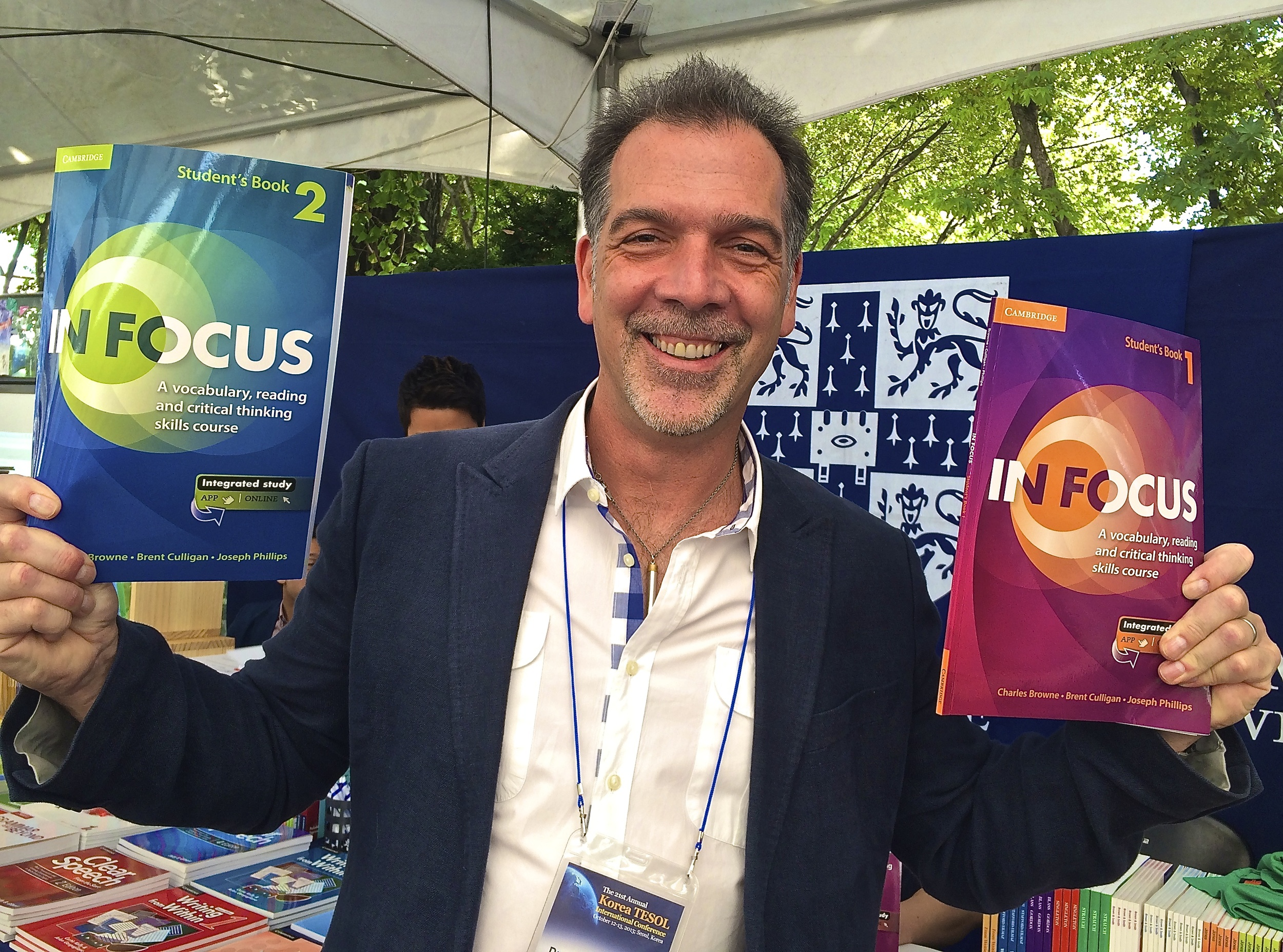 Dr. Charles Browne picking up the first copies of In Focus at the Cambridge booth at the KoTESOL Conference.