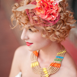 For a bit of neon spunk, get some inspiration from Elizabeth with her colored fascinator and birdcage veil